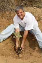 Tom planting a tree on KC's property