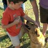 Adoptable dog Charlie meets his new family