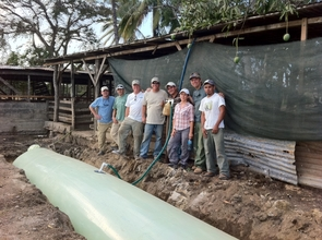 EARTH volunteers & staff with finished biodigester