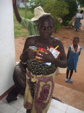 Tendai receiving food from the foundation