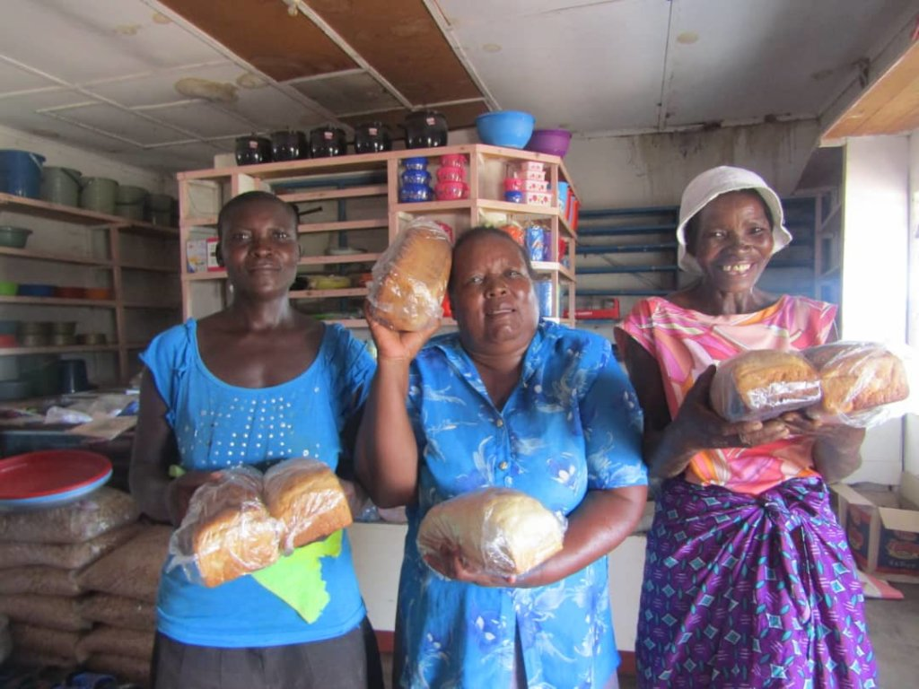 Needy families receiving bread for Christmas