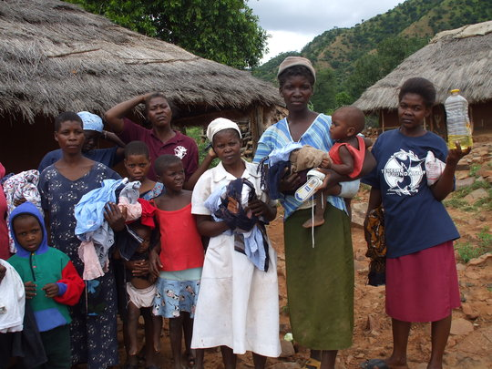 Beneficiaries receiving food and clothing
