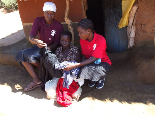 Beneficiary receiving clothing