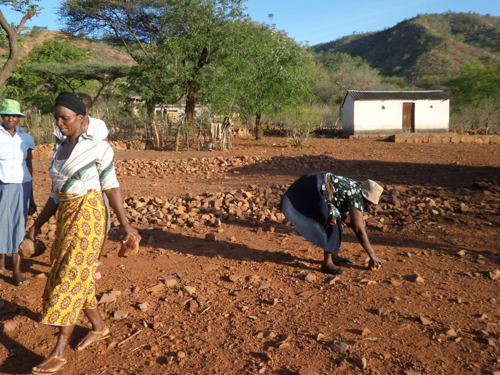 The Women Clearing The Location For The New Coop