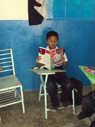 "Boy reading ""I want to, I can"" book"