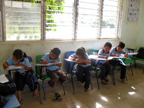 Chiapas participants completing evaluation forms