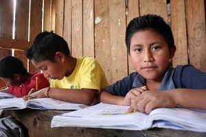 A program participant, working hard at school