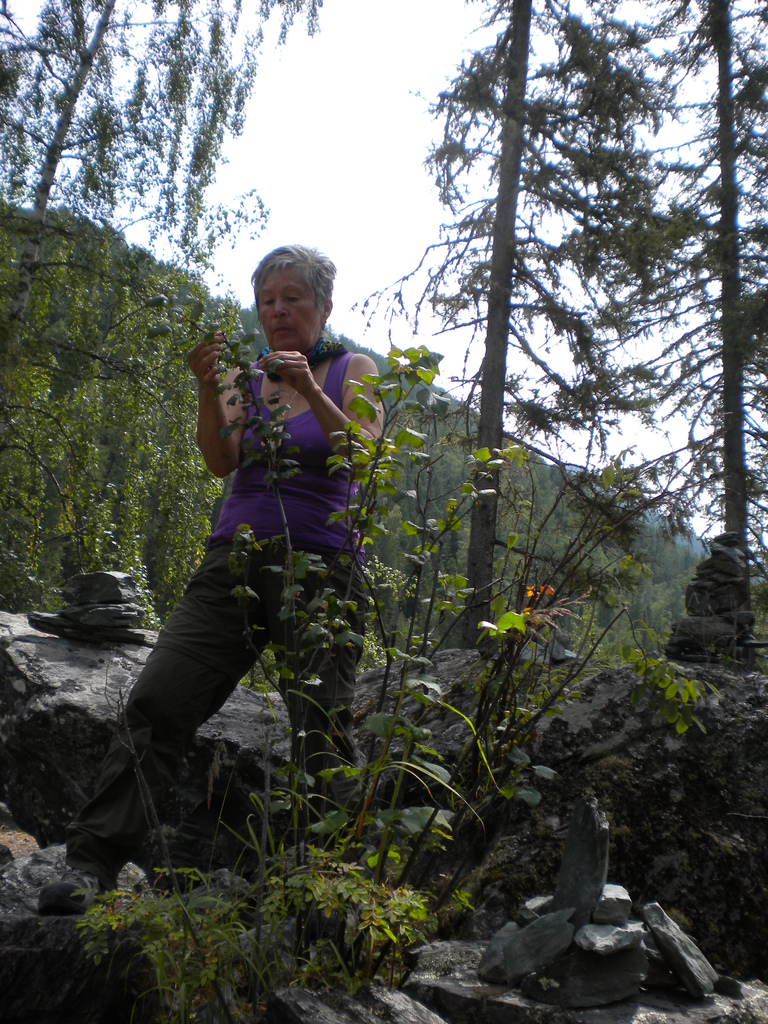 Patricia Anne Davis eating berries along the trail