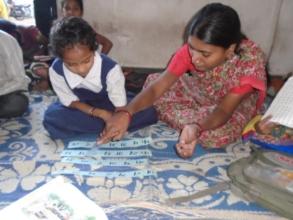 Heena with her teacher