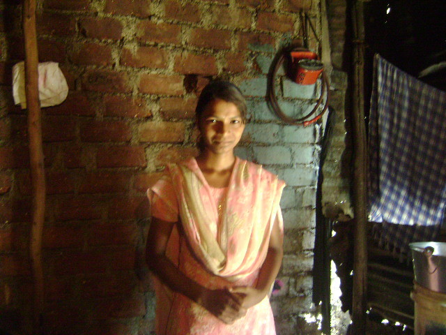 Lakshmi welcoming her Social Worker to her home