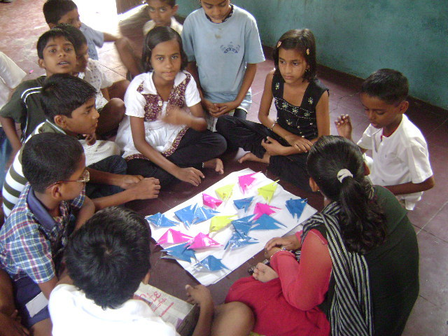 Youth group member teaching Paper craft