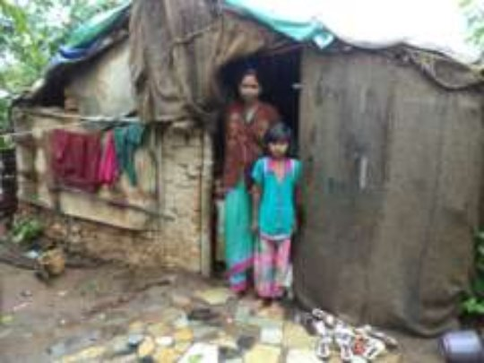 Sakshi & her mother in front of their house