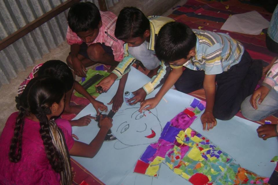 kids creating a colourful collage.