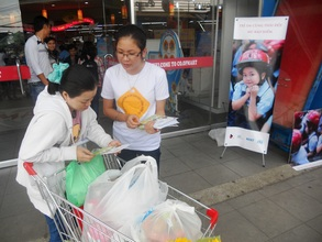 Handing out flyers to parents in Ho Chi Minh City