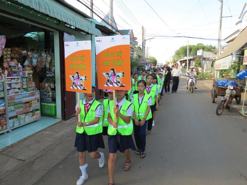 Students practicing safe pedestrian behavior
