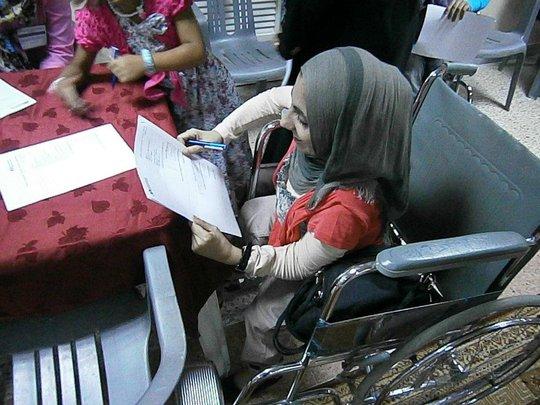 Woman Receiving Care at the Al Tadamoon Centre