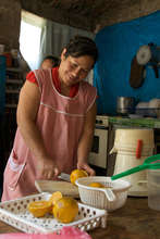 Maria Gonzalez cutting lemons in her store/bakery