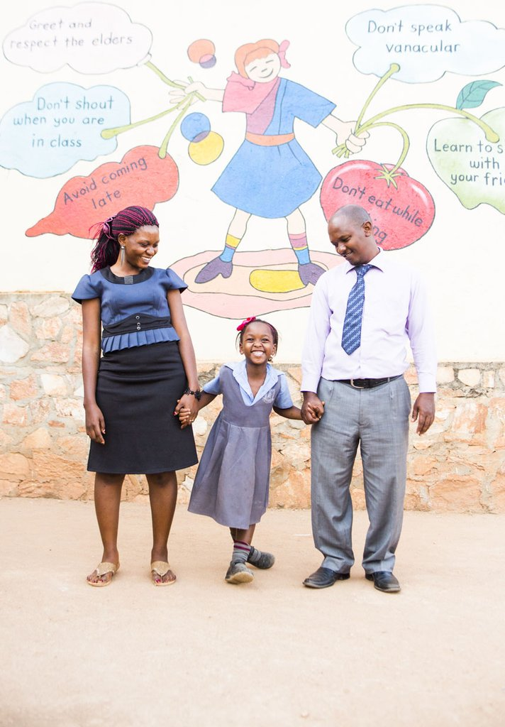 Evans with his wife, Roy, and daughter, Luyiga.
