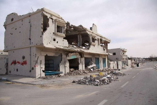 A heavily damaged home in the town of Sirte.