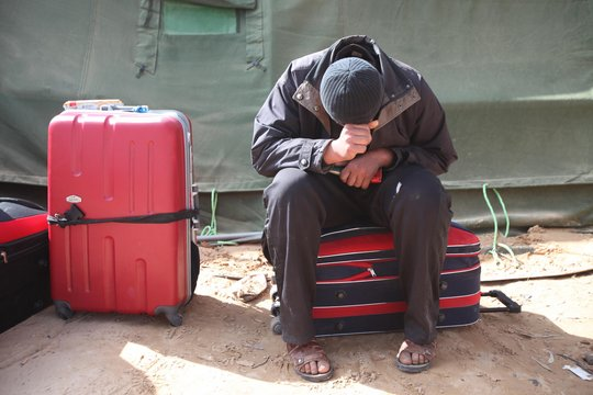 Refugee fleeing Libya in Ra's Ajdir, Tunisia.