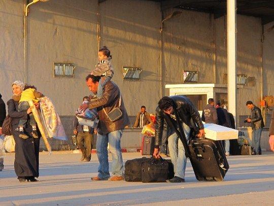 Family Crossing Libya-Tunisia Border