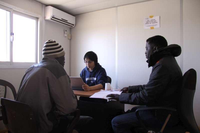 UNHCR staff interviews a Sudanese man in Sallum.