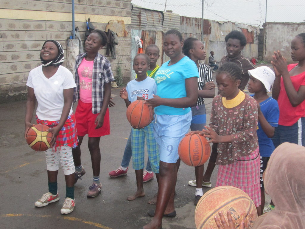 Girls learning basketball skills during the camps