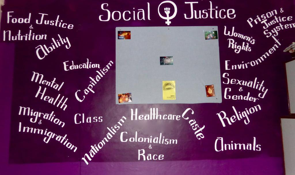 Volunteer Katelyn Painted Our Social Justice Wall