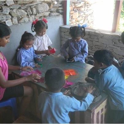 Laxmi Teaching Origami to Nepali Children