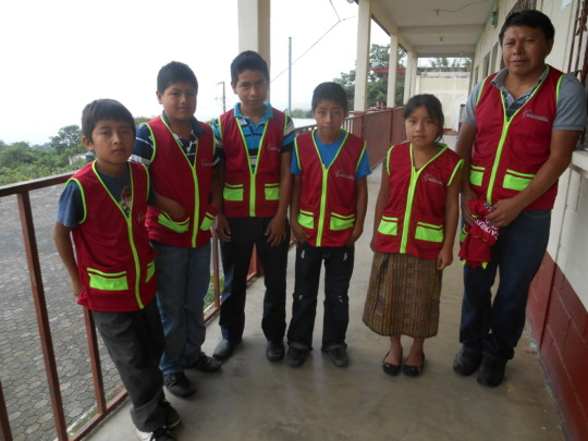 WASH teacher with students at Panimaquip