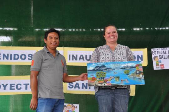 Tomas and Ana receive a gift from school leaders