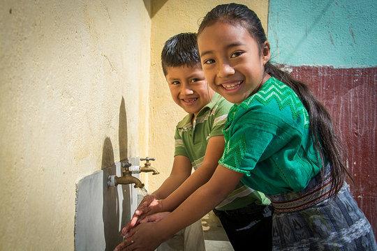 Students wash their hands in Panimaquip