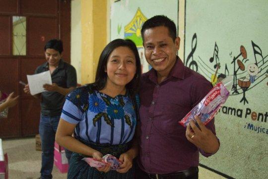 Teachers receiving Colgate supplies