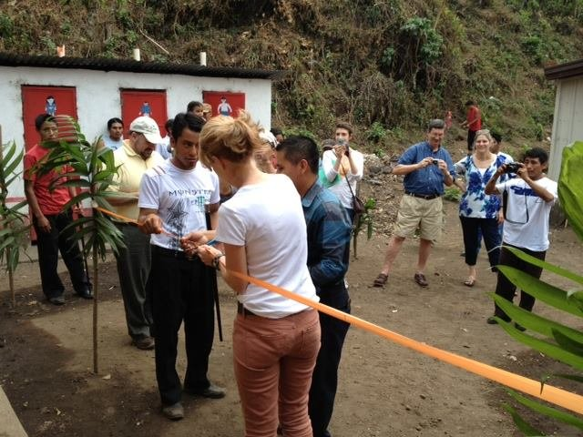 Rosemary, our Executive Director, cuts the ribbon