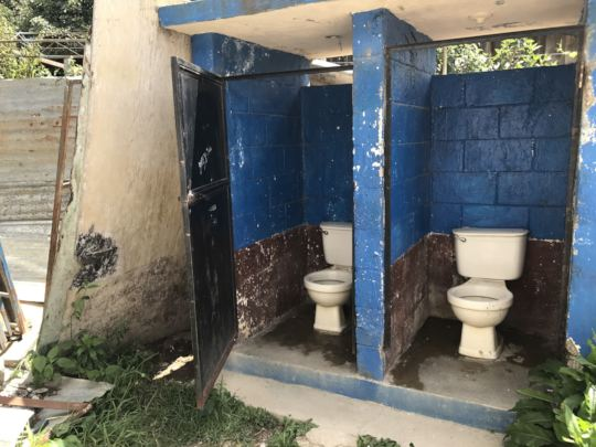 Soon-to-be replaced toilets with no seats or doors