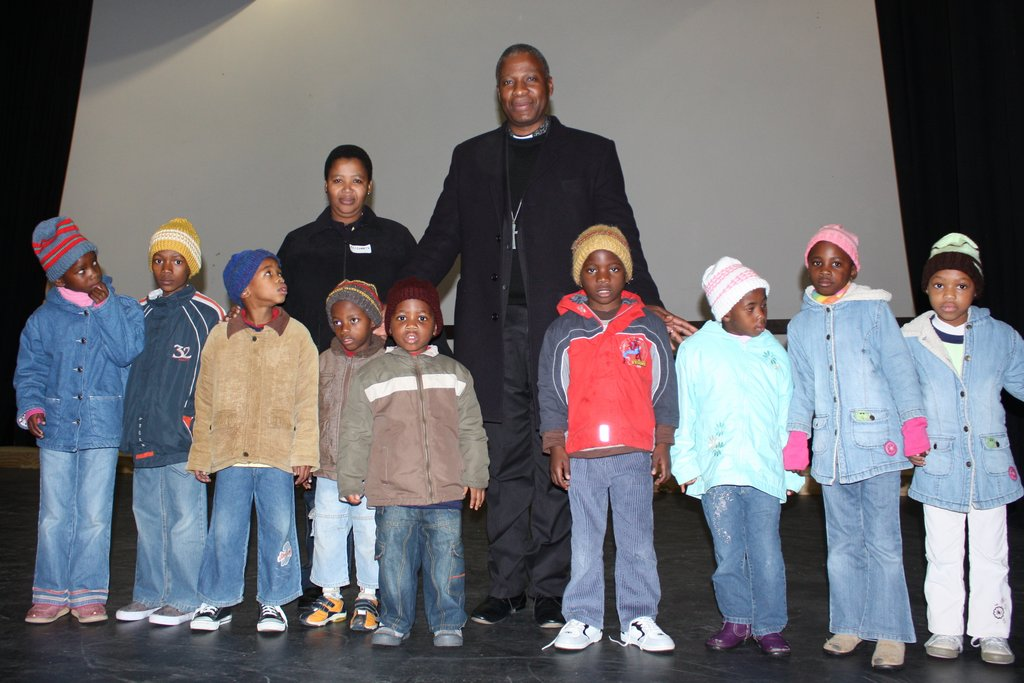 Fikelela children with Archbishop Thabo