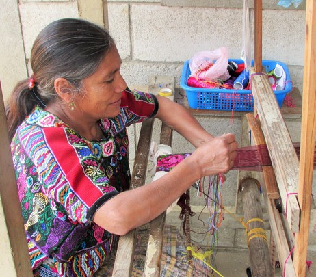Angela working on a faja (belt)