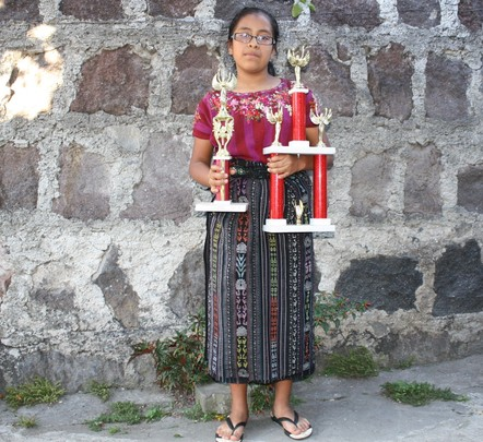 Josefa with her chess trophies