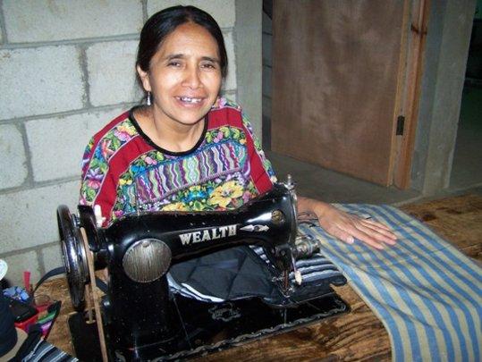 Maria Teresa sews a yoga mat bag.