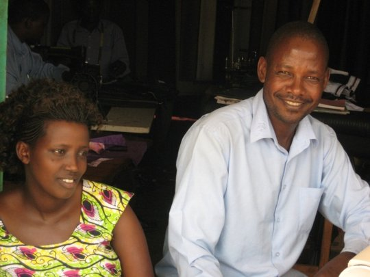 Faith and Frank in their tailoring shop