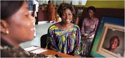 Annie Nyangomba receives a biometric ID card.