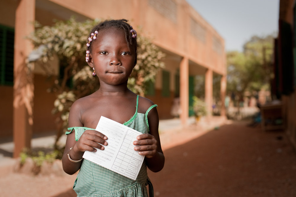 Shariphat Tapsoba, 5, with her vaccination record. Shariphat was vaccinated against meningitis A at her school in Ouagadougou, Burkina Faso. On December 6, 2010, people across Burkina Faso, Mali, and Niger began receiving a shot of a new meningitis vaccine. Read more at www.path.org/menafrivac/.
