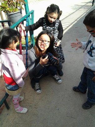 Elaine showing the children her camera