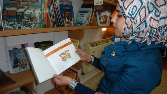 Librarian Haneen w new books @ Ibn Rush'd Library