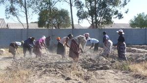Zimkids Caregivers tilling the garden