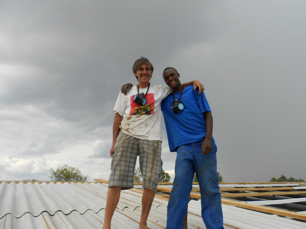 Dennis and Foster assembling roof on Resource Cntr