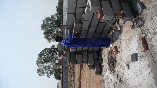 Foster, 18, laying block for the Resource Center