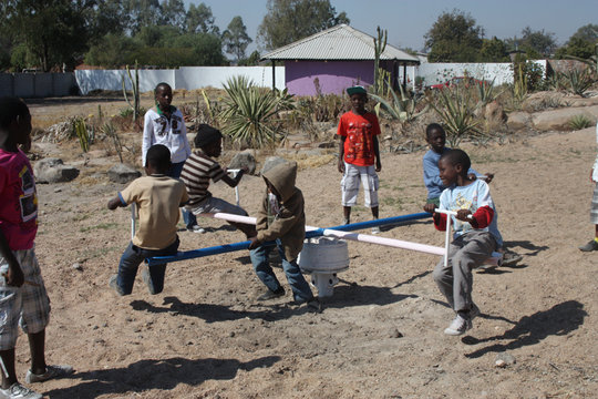 Zimkids playing on Merry-go-round