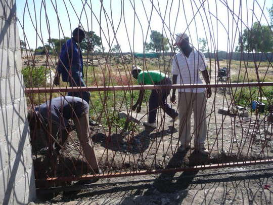 Seniors installing the gate