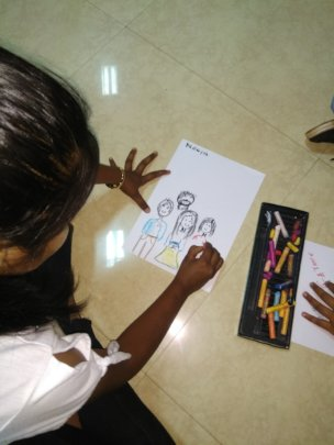 Children drawing their Ideal Family